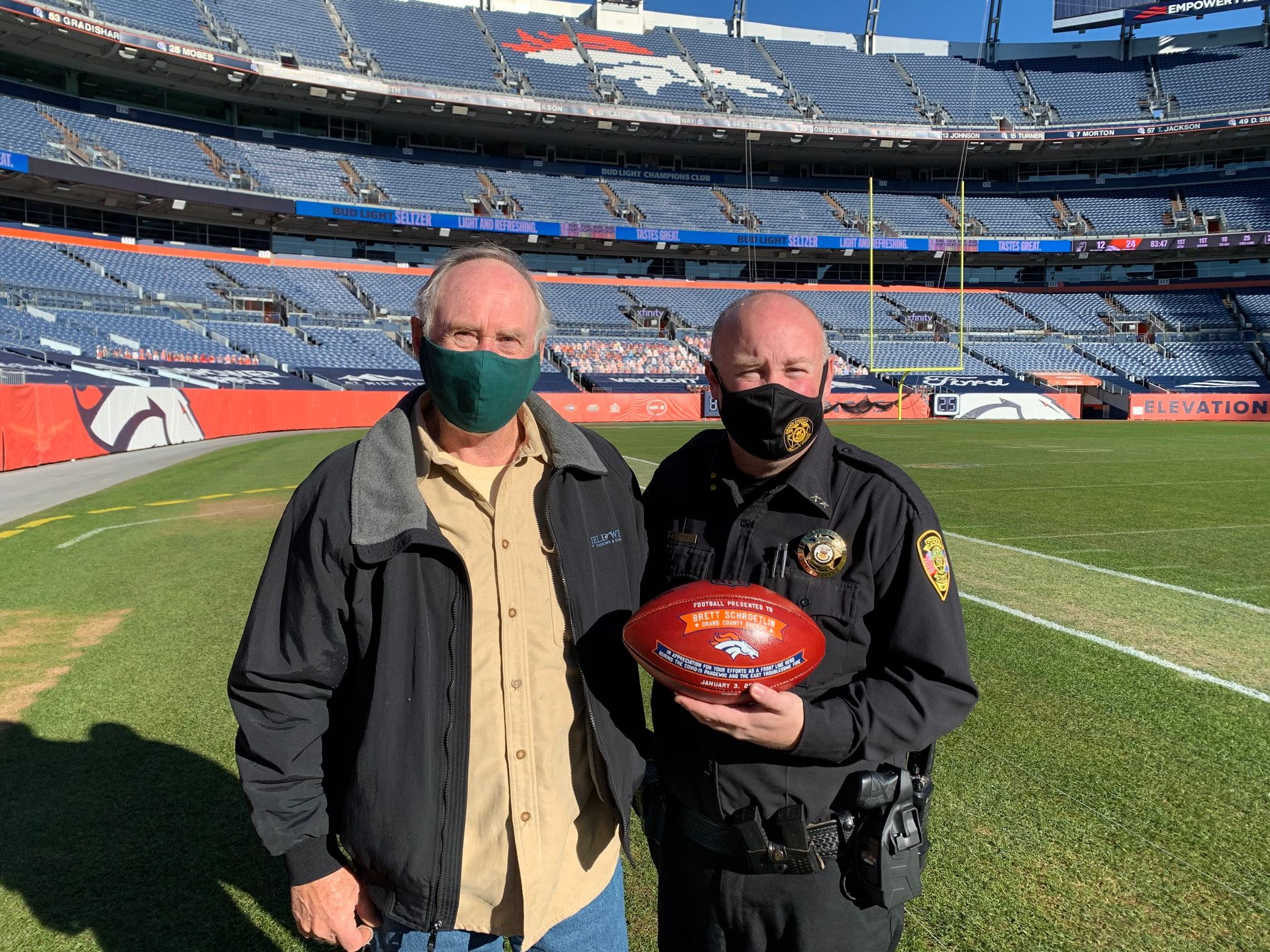 Grand County Sheriff Schroetlin with his Father Dave Schroetlin at Empower Field at Mile High